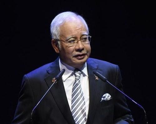 Малайзын ерөнхий сайд асныг хилээр гарахыг хоригложээ